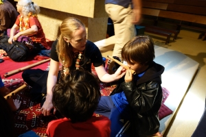 Punahou student tries the bansuri flute (Photo courtesy of East-West Center)