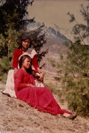 Anjana Gurung (seated, in red) and unidentified fellow artist with Chitwan Cultural Family, Humla, 1991.