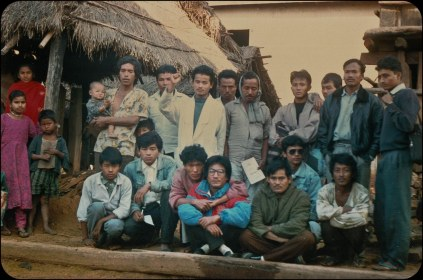 "Samana Cultural Family with locals in Makwanpur, sometime after the start of the ""People's War"" in 1996."