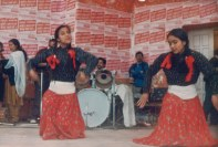 Sharada Shrestha (left) and unidentified Chitwan Cultural Family dancer, Khulla Manch, Kathmandu, 1991.