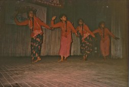 "Dancers from Chitwan Cultural Family, same date and place as Chunu Gurung's performance of ""Aamako Mutu"" with Parijat condolence banner. Kathmandu or Chitwan, 1993."