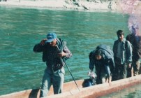 Samana crossing the Karnali river in a canoe, sometime between 1996 and 2006.