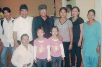 Khusiram Pakhrin with local artists in Austria, plus twin girls whose last name is also Pakhrin, 2009.